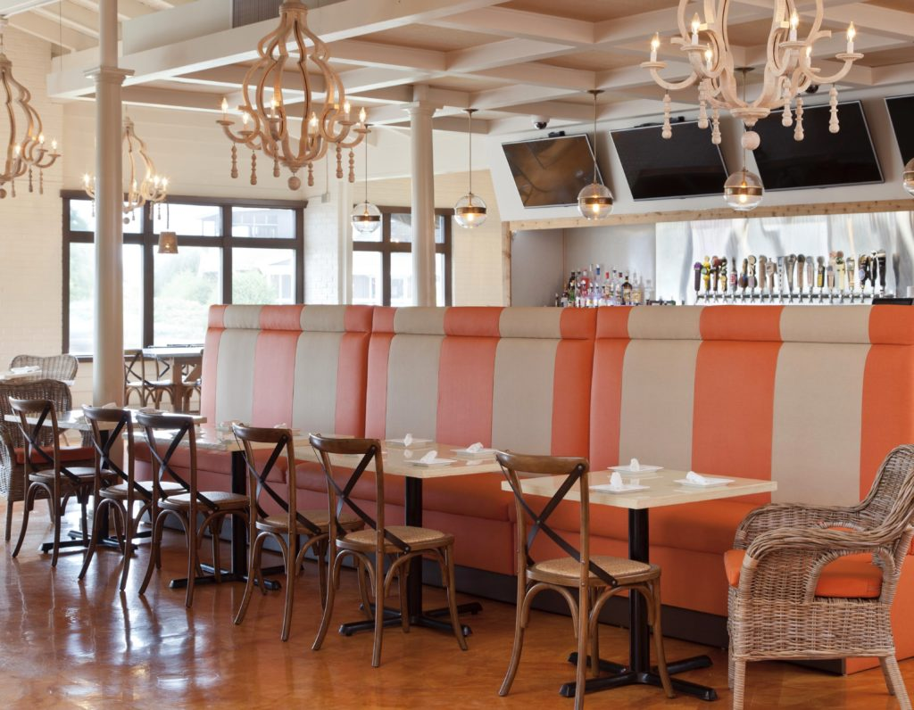 rooster southern kitchen, janie molster designs, richmond interior design, kill devil hills, stripes, striped banquette, coral and beige